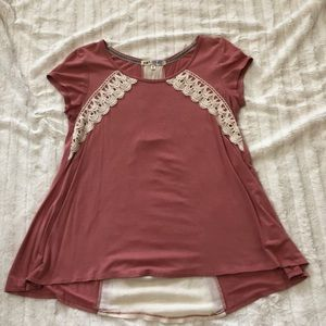 Pink top with lace design and lace up back